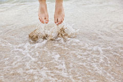 Feet of jumping boy at the beach Stock Photos