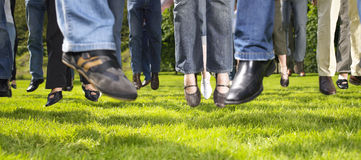Feet Jumping on the Grass Royalty Free Stock Photography