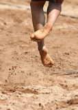Feet and legs of a boy beach volleyball player Royalty Free Stock Photos