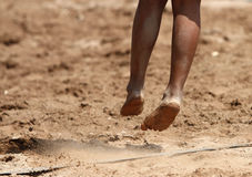 Feet and legs of a boy beach volleyball player Stock Image