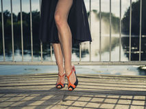 Feet and legs of elegant woman by lake Royalty Free Stock Images