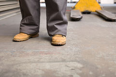 Feet and legs of a person in warehouse Stock Photography