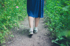 Feet and legs of woman walking in forest Royalty Free Stock Photo
