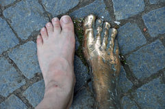 Feet: life and bronze Stock Photos