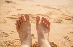 Feet of little boy standing alone on the sand. Beach Stock Photos