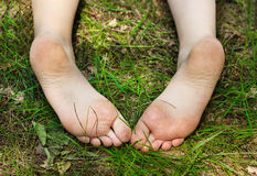 Feet of little girl outdoors. Feet of little girl in summer day Stock Photography