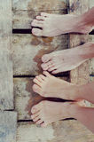 Feet lovers on the bridge Stock Image