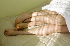 Feet of loving caucasian couple Stock Photography