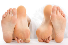 Feet making love Stock Images