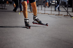 Feet male athlete in ski-roller Stock Photo