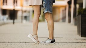 Feet of male and female close to each other, girl raising on tiptoes, dating royalty free stock photo
