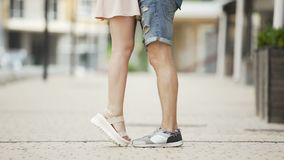 Feet of male and female coming to each other, girl raising on tiptoes, dating. Stock footage stock video