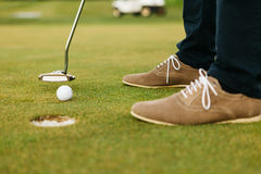 Feet of male golf player Royalty Free Stock Photos
