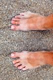 Feet of man at the beach Royalty Free Stock Photos