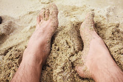 The feet of a man on the beach Stock Photo