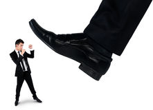 Feet man crushing little business man Stock Images