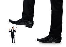 Feet man crushing little business man Royalty Free Stock Photo