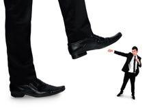 Feet man crushing little business man Stock Photos