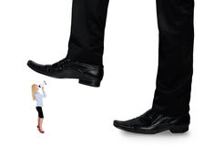 Feet man crushing little business woman Stock Images