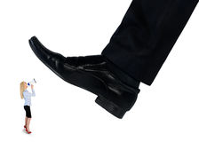 Feet man crushing little business woman Royalty Free Stock Images