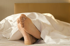 Feet of a man lying down Stock Image