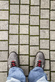 Feet of a man on the pavement Royalty Free Stock Images