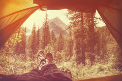 Feet Man relaxing enjoying clouds mountains aerial view from tent camping Royalty Free Stock Photography
