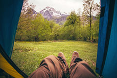 Feet Man relaxing from tent camping entrance outdoor Royalty Free Stock Photo