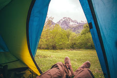 Feet Man relaxing from tent camping entrance outdoor Stock Images