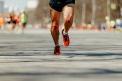 Feet man runner. Marathon race on spring city street royalty free stock images