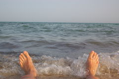 Feet of man in sea Stock Images