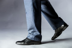 Feet of man in shoes Stock Images