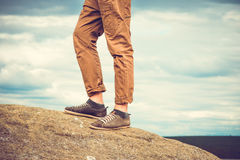 Feet man standing on rocky mountain outdoor Stock Photo