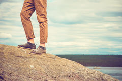 Feet man standing on rocky mountain outdoor Royalty Free Stock Photo