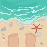 Feet of a man standing on the sea shore Stock Photos