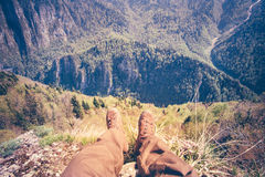 Feet Man Traveler relaxing on cliff mountains outdoor Stock Photography