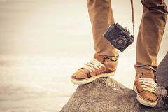 Feet man and vintage retro photo camera outdoor Stock Photography
