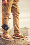Feet man and vintage retro photo camera outdoor Stock Photo