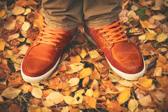 Feet Man walking on fall leaves Outdoor. With Autumn season nature on background Lifestyle Fashion trendy style Stock Photos