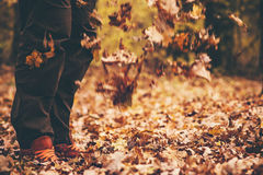 Feet Man walking Outdoor with fall leaves Stock Photo