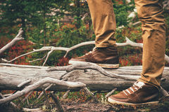 Feet Man walking Outdoor Travel Lifestyle Fashion. Trendy style forest nature on background film effects colors stock photos