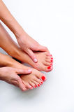 Feet Massage. A woman giving massage herself Royalty Free Stock Photos