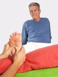 Feet and massage. Stock Photos