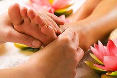 Feet massage Stock Photos