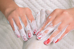 Feet massage with cream Royalty Free Stock Image