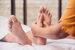 Feet massage. In spa salon stock photography