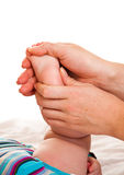 Feet massage of infant girl Royalty Free Stock Images