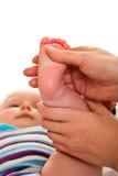 Feet massage of infant girl Stock Photos
