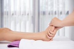 Feet massage Stock Photography