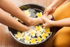 Feet massage. In spa salon stock photos